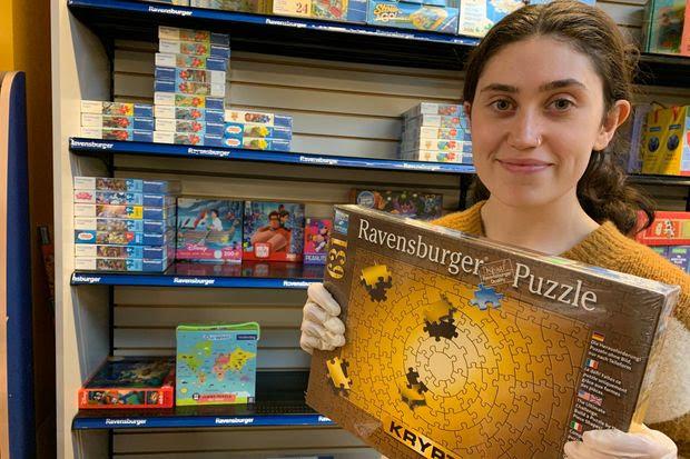 Art manager Anya Navidi-Kasmai holds the sole remaining Ravensburger adult puzzle at Sullivan's Toys & Art Supplies in Washington, D.C.