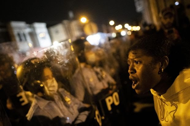 A demonstrator shouts at police during a protest near where Walter Wallace, Jr. was killed.