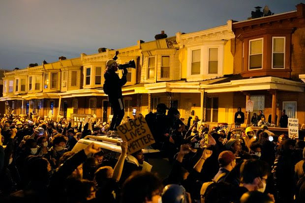 Demonstrators in Philadelphia confront police during a march Tuesday protesting the death of Walter Wallace.