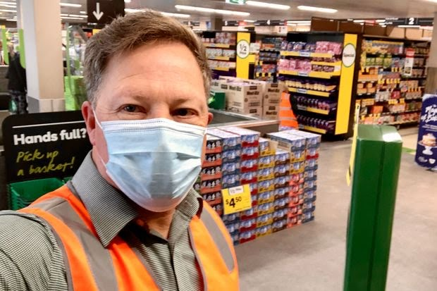 Furloughed commercial pilot Greg Harper at one of his new jobs at a local supermarket chain.