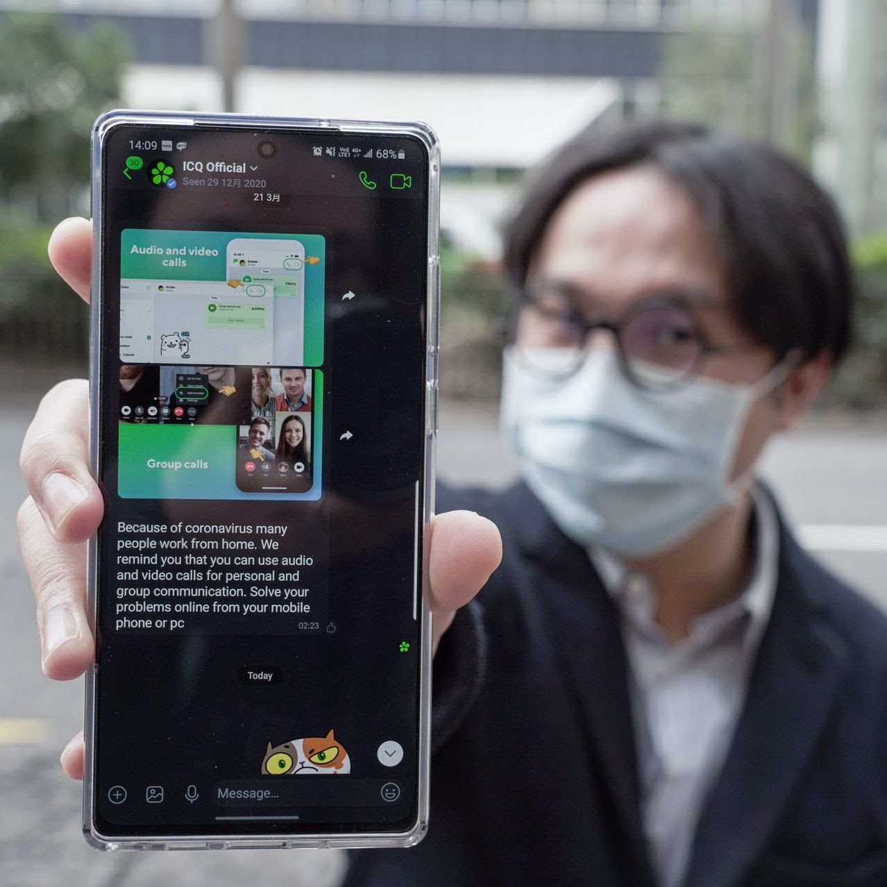 Anthony Wong showed an ICQ chat on his phone last week.
