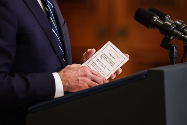 President Biden held notes on infrastructure while speaking during a news conference in the East Room of the White House on March 25.