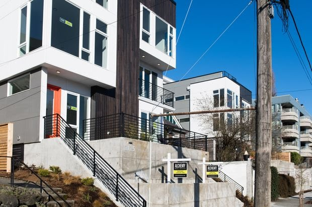 Townhouses for sale in the Queen Anne neighborhood of Seattle. A combination  of lower mortgage rates, a slowdown in the growth of prices and more homes on the market is seen boosting spring sales.